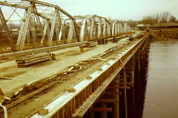 1955  photo showing old (1920) and new bridges at Marsing, Idaho. The old bridge was south of the bridge being used today.